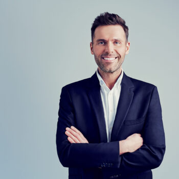 Happy,Businessman,Isolated,-,Handsome,Man,Standing,With,Crossed,Arms