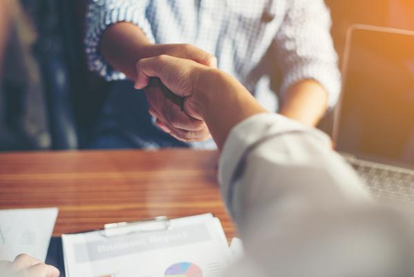 Adult site broker closing deal on adult website with handshake