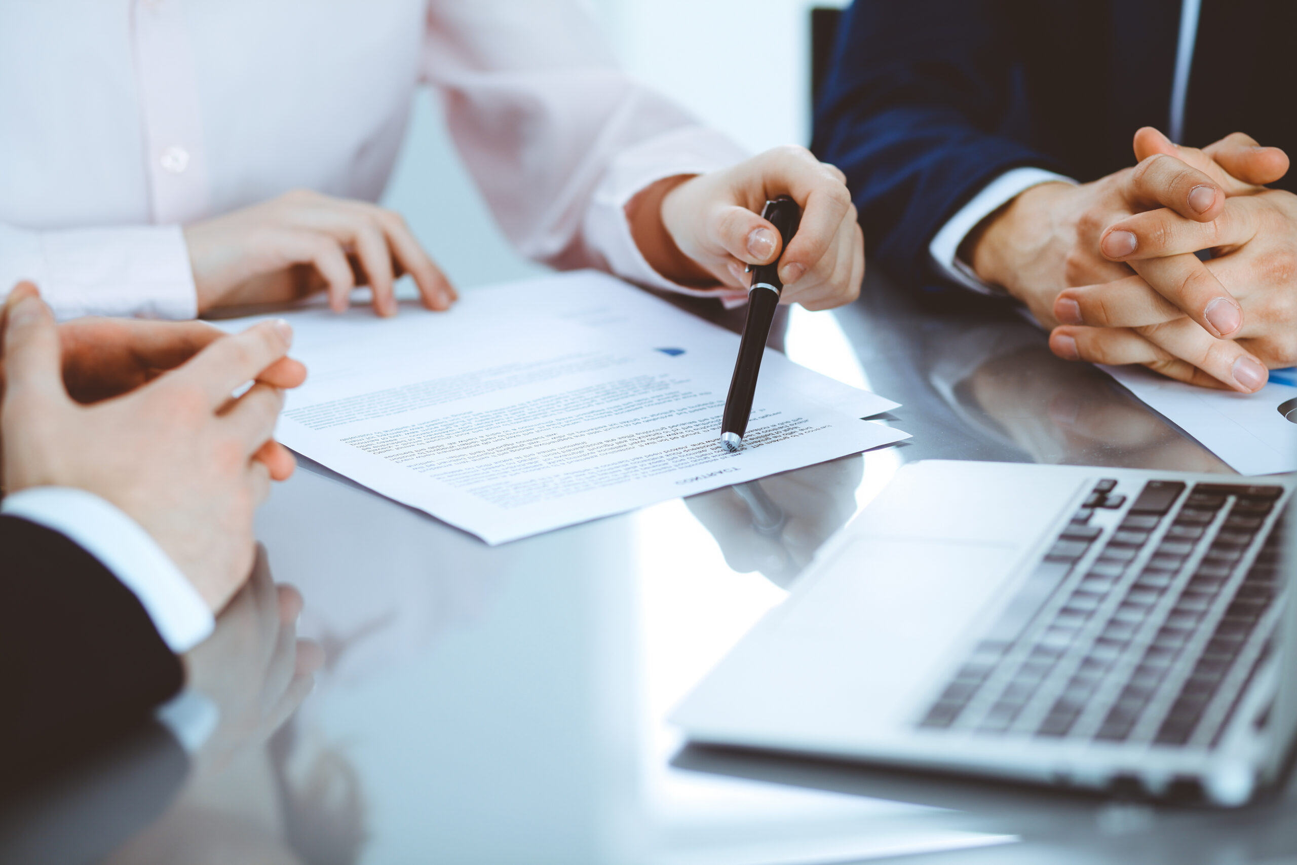 Group of business professionals examining report