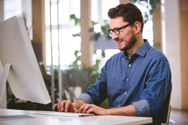Bearded man with glasses selling adult Ecommerce site on desktop