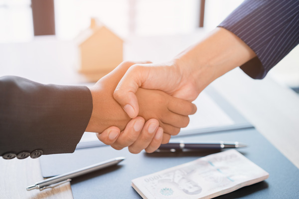 Closing a deal on online dating site with handshake