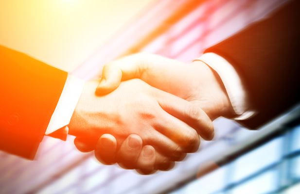 Close-up of adult industry professionals shaking hands