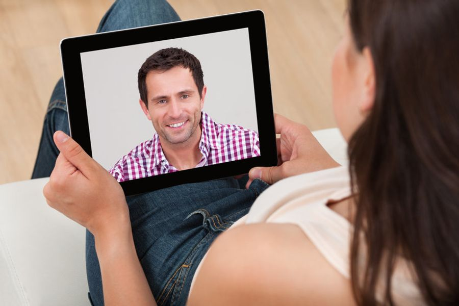 Adult site broker consulting with young woman on tablet