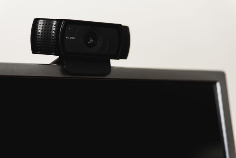 High-quality webcam attached to top of laptop computer