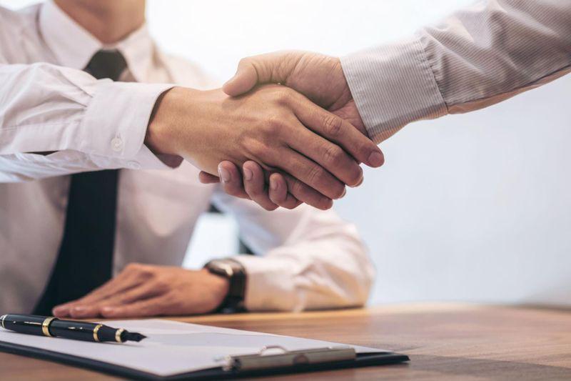 New adult website investor shaking hands with adult site broker